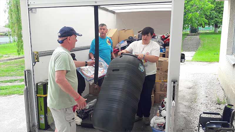 Volunteers unloading a CWUHA truck