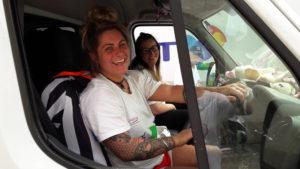 Volunteers driving a CWUHA truck